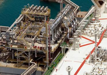 Loading of liquefied natural gas in the 'Al Gattara' LNG tanker on the Qatar jetty - Exploration Production - TotalEnergies